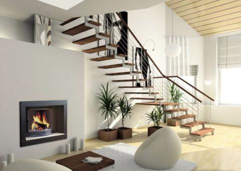 Прекрасное расположение камина под лестницей в гостиной