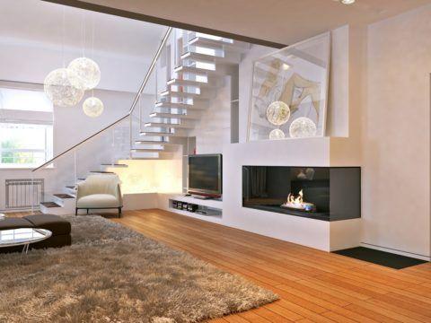 Современная гостиная с лестницей и пристенным камином