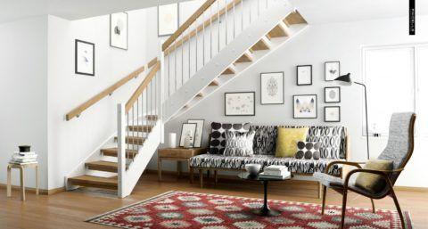 Декоративный уголок для лестницы в гостиной в виде зоны отдыха