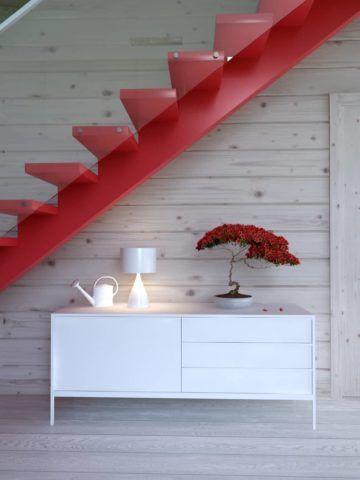 Металлическая лестница на косоуре в современном интерьере